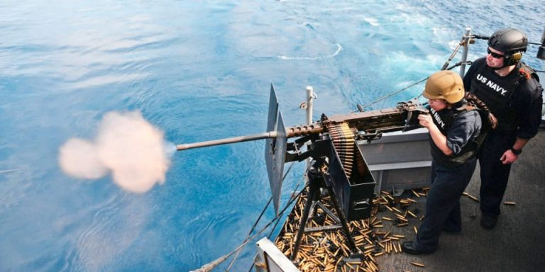 U.S. Navy ship fired warning shots at Iranian vessels