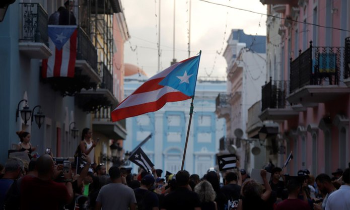 Thousands of people take to the streets in a new day of protests to demand the resignation of Roselló