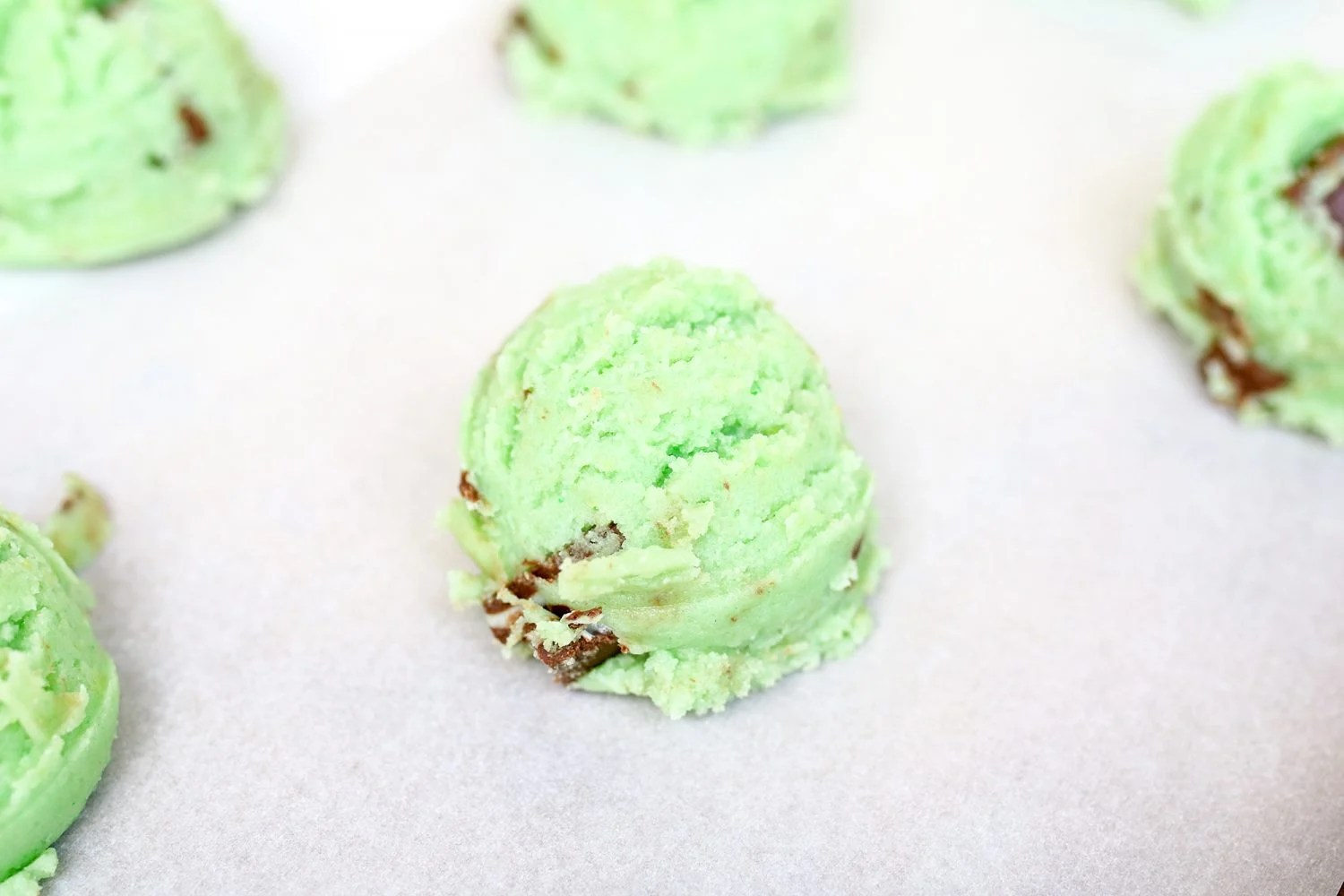 The scoops of green mint chocolate chip cookie dough look like ice cream ready for baking!