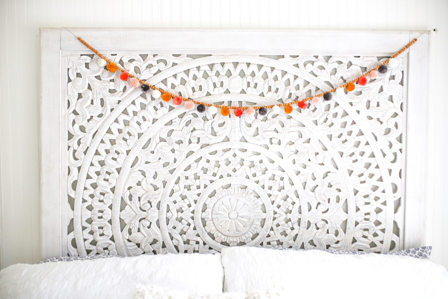 Beautiful headboard and decor at an AirBnB in Florida