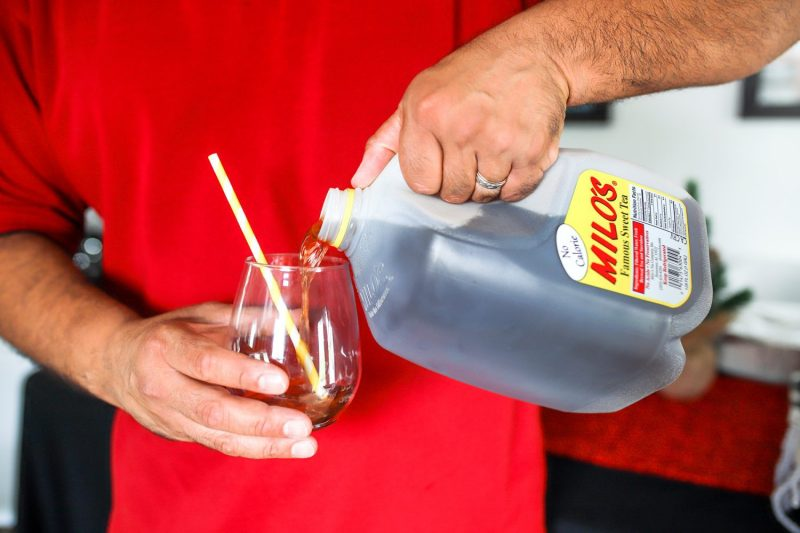 pouring milo's sweet tea into a cup