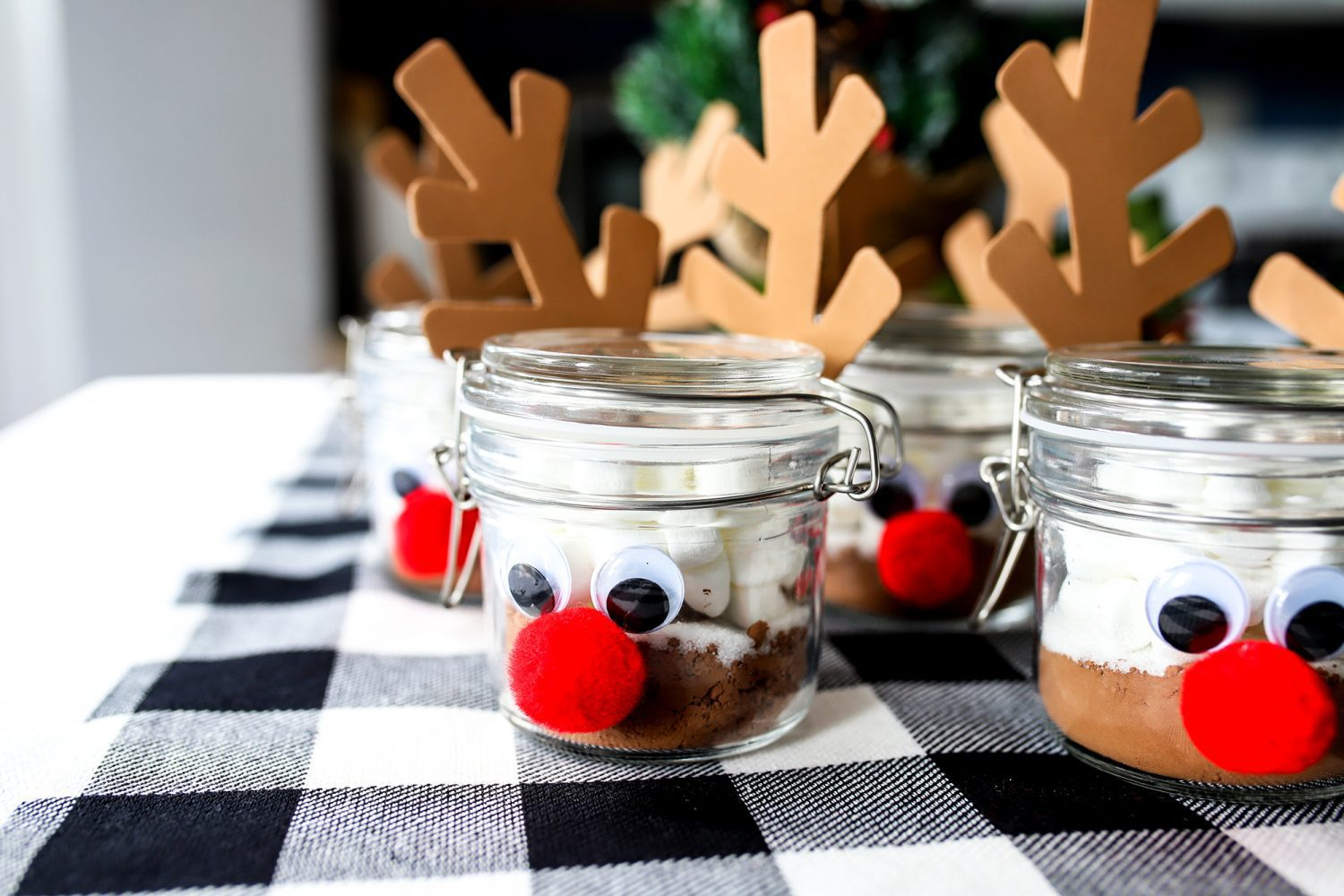 reindeer jars filled with hot cocoa ingredients