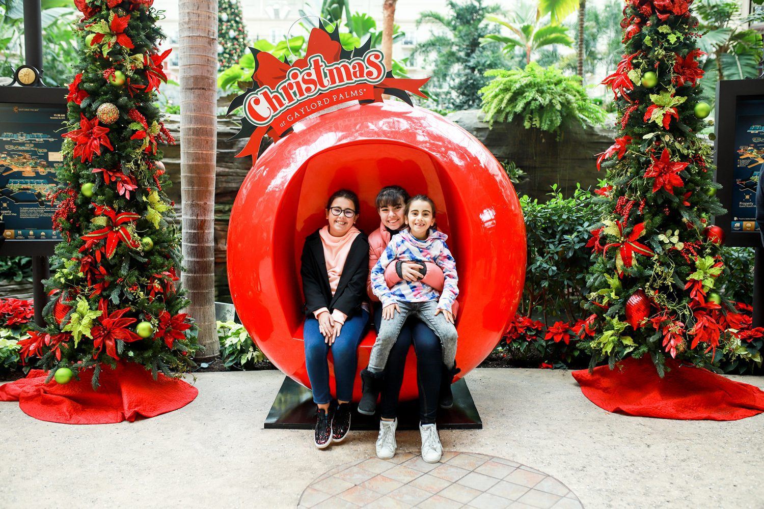 Sisters posing in ornament at Gaylord Palms in Orlando, FL