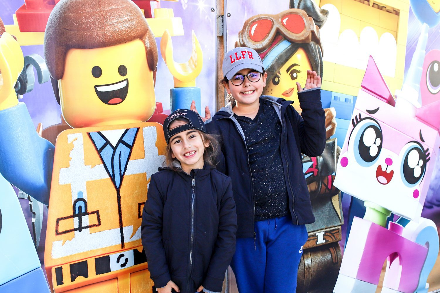 sisters in front of wall at legoland