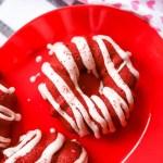 plate full of red velvet donuts