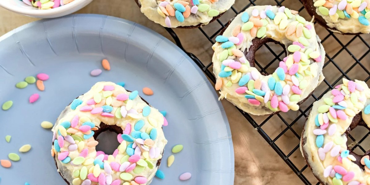 Baked Double Chocolate Chip Donuts with Fresh Banana Icing Perfect for Spring or Easter