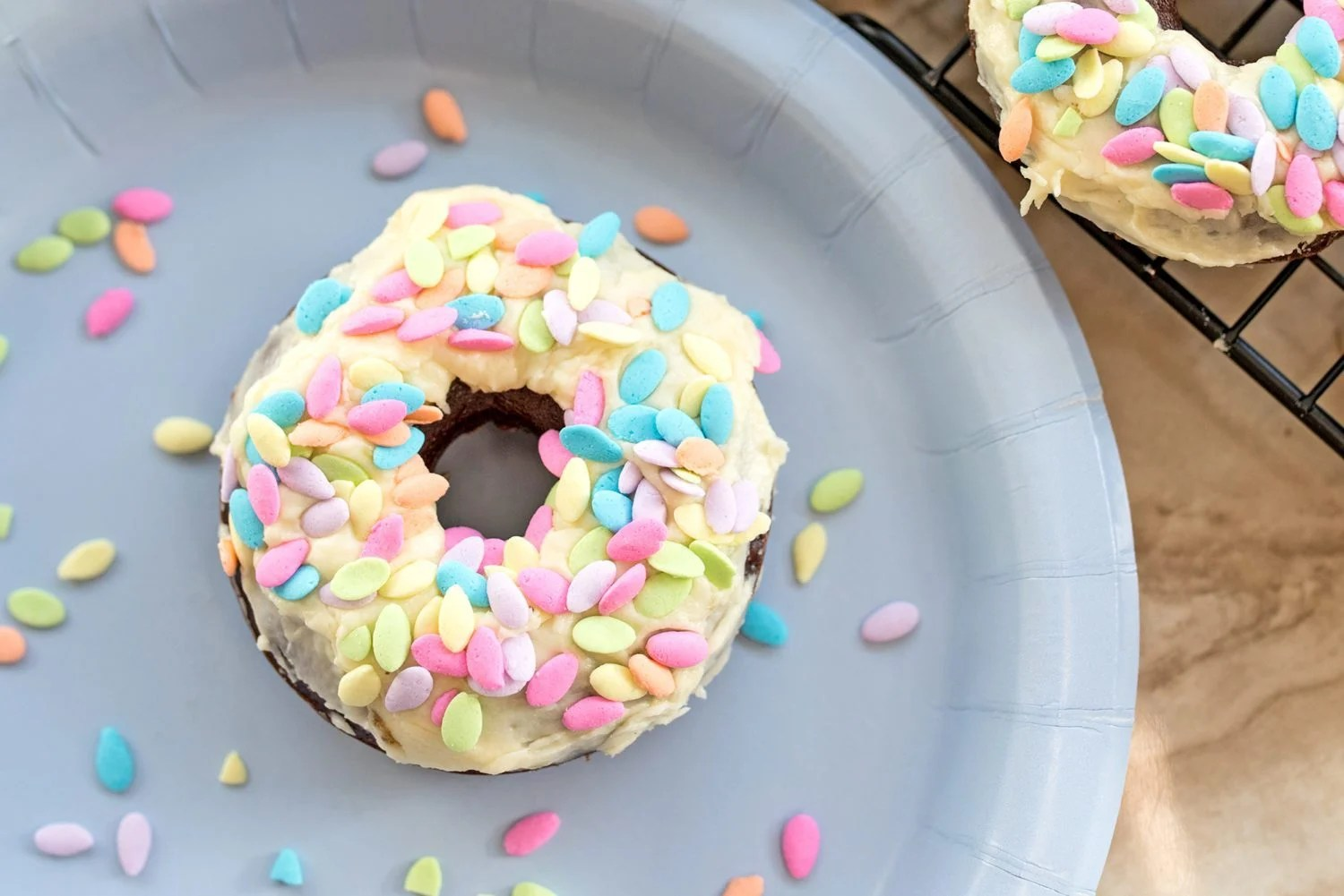 donut on a plate with sprinkles around it