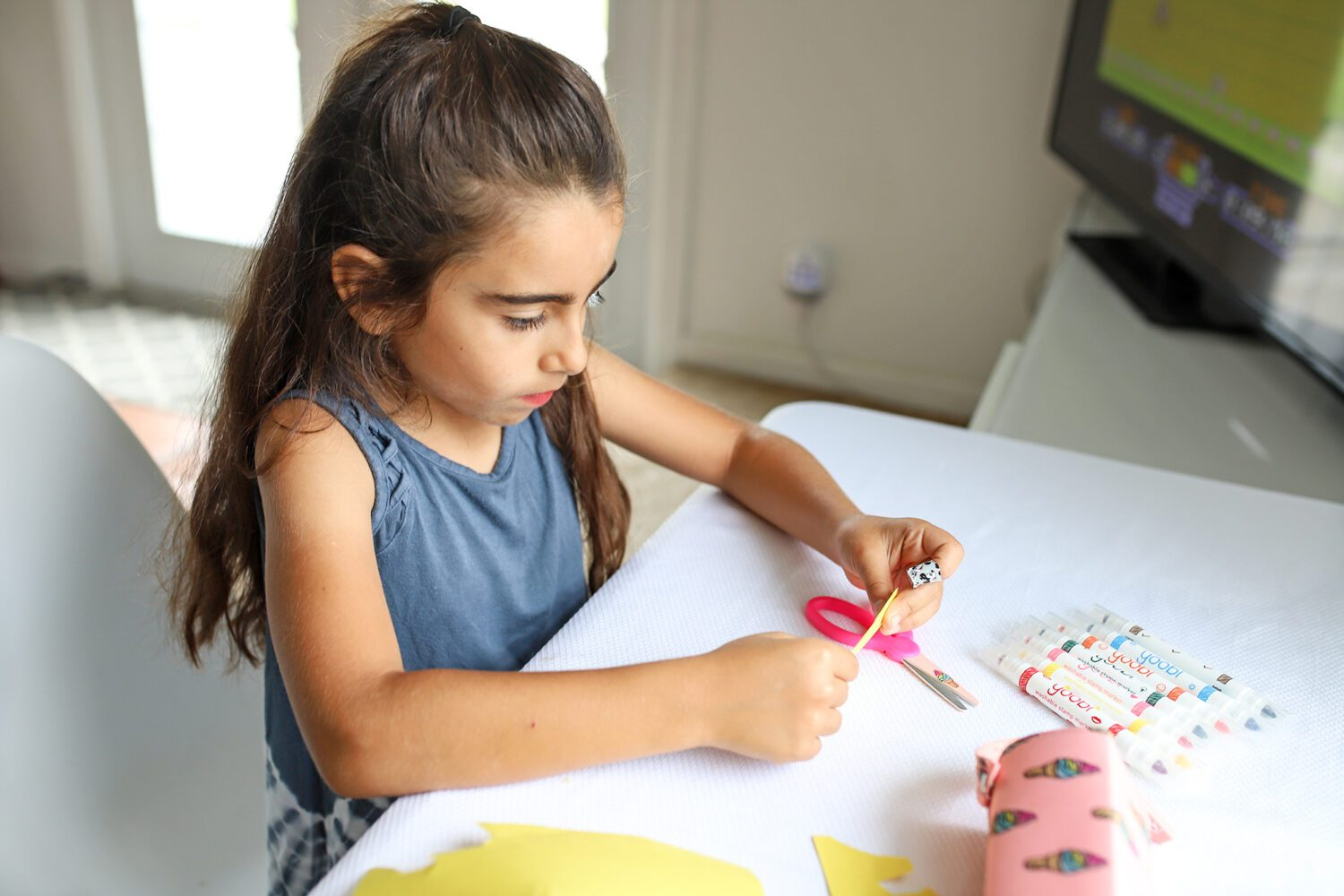 young girl making a craft