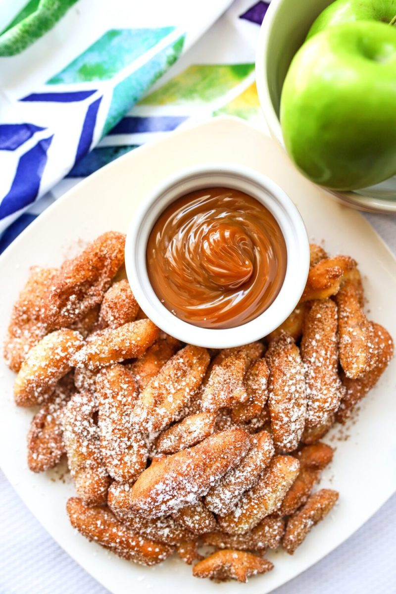 plate of cinnamon sugar apple fries with caramel dipping sauce