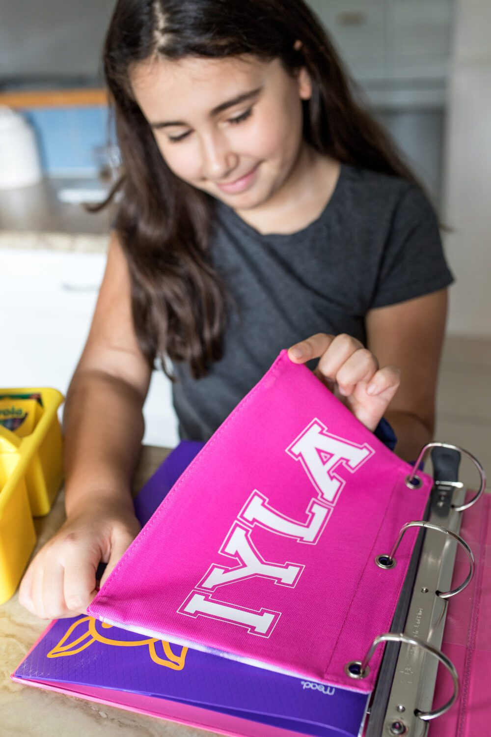 girl holding a personalized pencil pouch