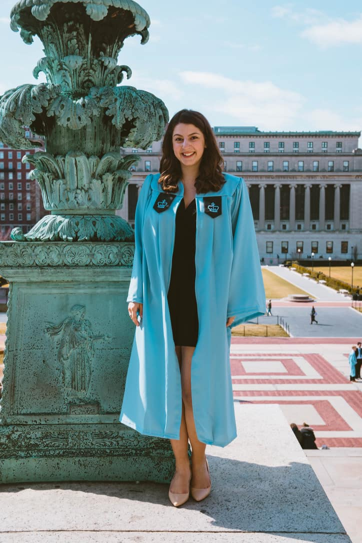 young lady standing in her graduation robe