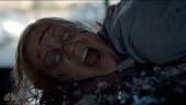 a possessed woman on a van hood