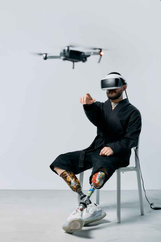 photo of man pointing on a flying drone