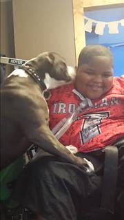 Xzavier Davis-Bilbo with his dog