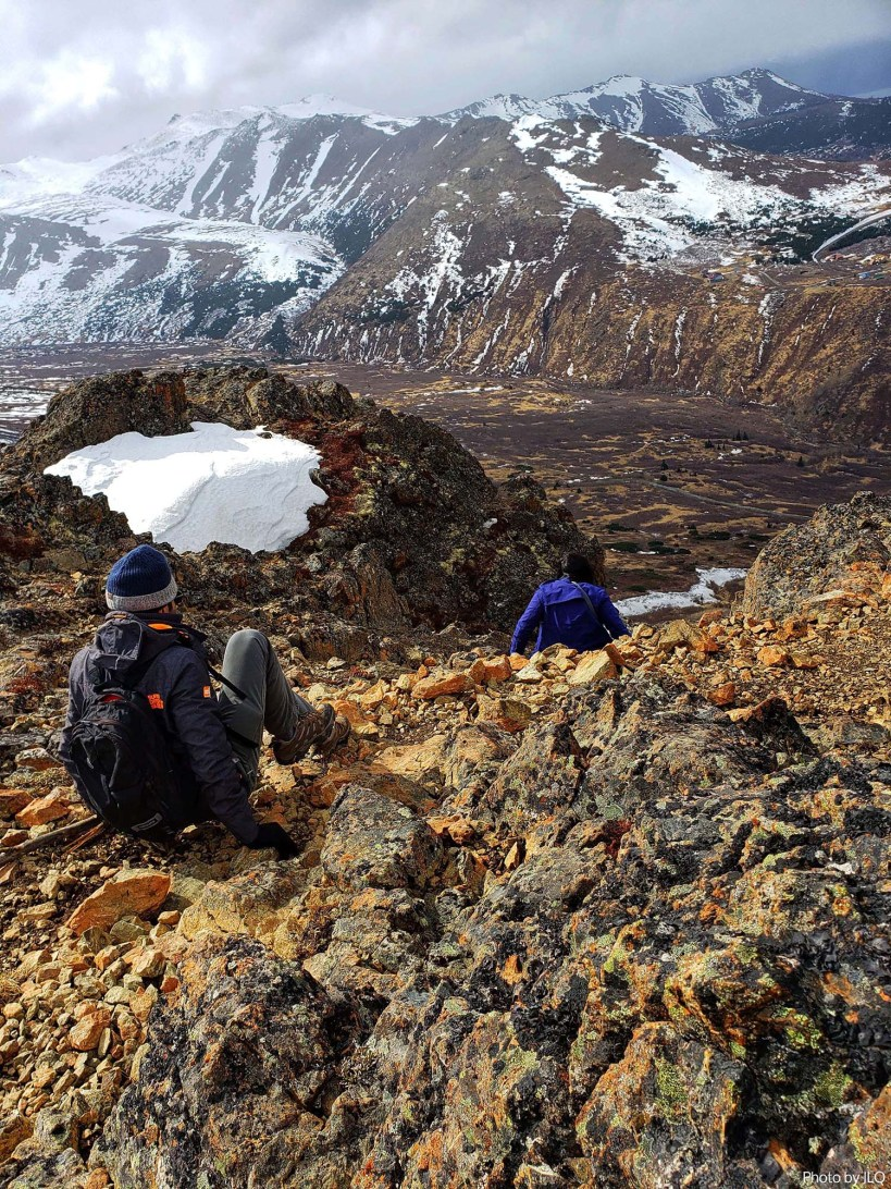 On our butts at Flattop mountain in Chugach State Park in Anchorage, Alaska