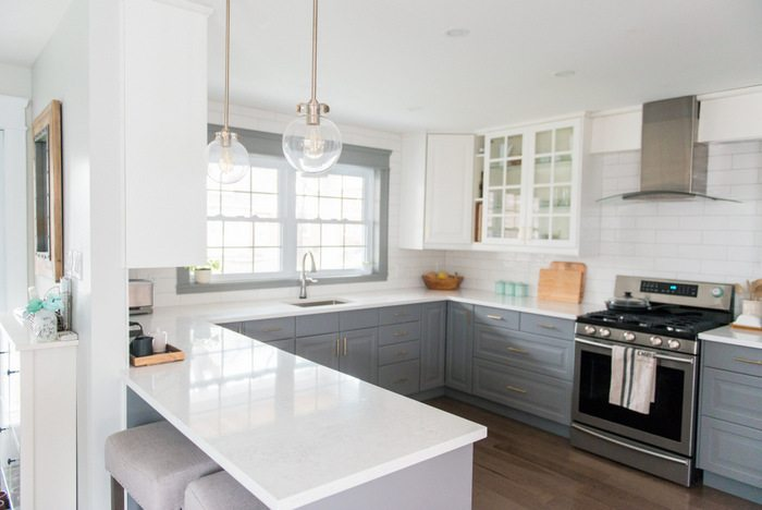 gold kitchen faucet suppy fixing my design mistake with a by delta the gray and white makeover using ikea cabinetry marble like quartz countertops subway