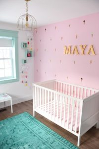 A Baby Girl's Mint And Pink Nursery