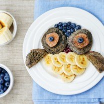 blueberry chocolate pancake with bananas in the shape of an owl for kids