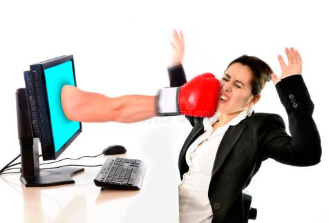 woman-computer-hit-boxing-glove-social-media-cyber-mobbing-business-bullying-concept-40175957