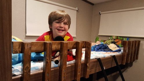 Cameron excited to sleep in his bunk for the first time!