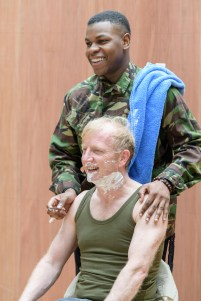 John Boyega (Woyzeck) and Steffan Rhodri (Captain Thompson). Woyzeck at The Old Vic, photo by Manuel Harlan
