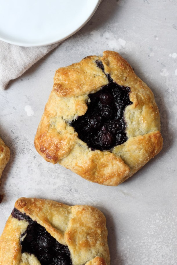 Individual blueberry galette with a cornmeal crust