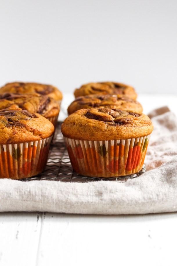 Six pumpkin Nutella muffins on a linen napkin.