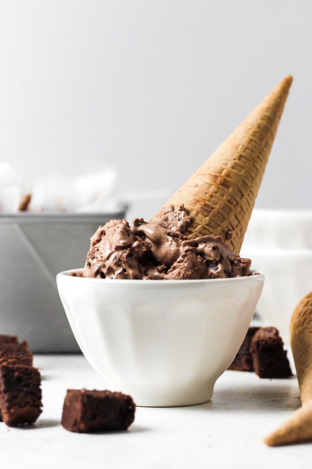 Upside down cone of No Churn Chocolate Brownie Ice Cream in a bowl