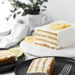 Loaf of lemon icebox cake with two slices on plates.
