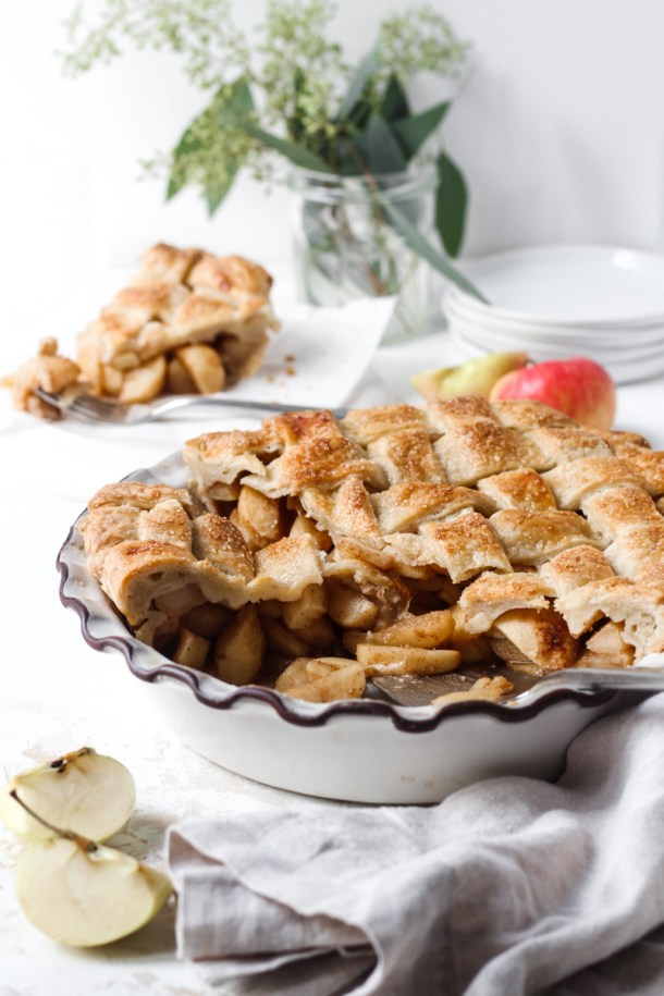 Chai spiced apple pie with three slices removed and one slice in the background.