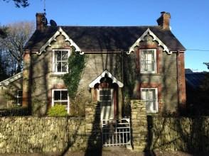 Mrs Walsh's Cottage bathed in winter sunshine