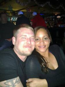 """Ben and I at a favorite bar we used to go too. It's special because it was our first photo together."""