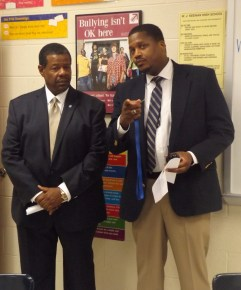 Mr. Alvin Pressley, principal (right), shows Dr. Ronald Rhames, MTC president (left), around the school.