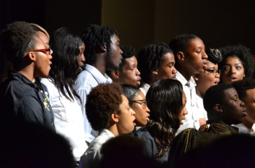 The school choir gives two selections to contribute to Black History Month. Photo by Mr. Stephen Milligan, Staff Photographer.