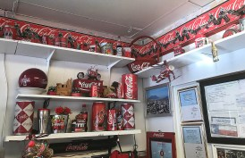 Coca-Cola memorabilia adorns a corner of Lucy Cafe.