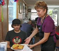 Yolonda Espinoza serves an enchilada plate to Nancy Garza recently at Mendez Cafe. Espinoza has been working at the restaurant for 24 years. Garza has been going since she was a child with her family. Brianna Rodrigue / Special to The Tacoist