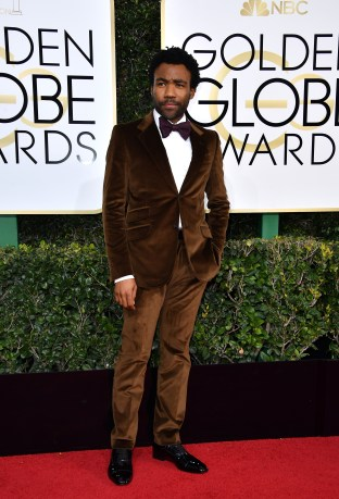 Donald Glover (Childish Gambino to many) wore this tobacco Gucci ensemble in velvet for the 2016 Golden Globe Awards. Photo: Getty