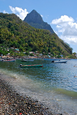 The shoreline in Soufriere, looking up at The Pitons