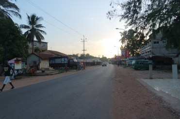 hitchhiking the road from Bakau to Banjul while Traveling The Gambia