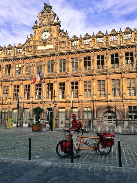 a male cyclist on a tandem bicycle in Valenciennes, France