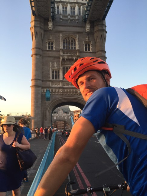 A man riding his bicycle on the Tower Bridge in London, in the United Kingdom