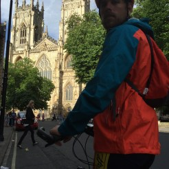 bicycle rider in front of Notre Dame in London