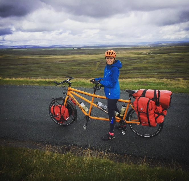 Woman on a tandem bicycle in the Yorkshire Dales National Park, in the United Kingdom