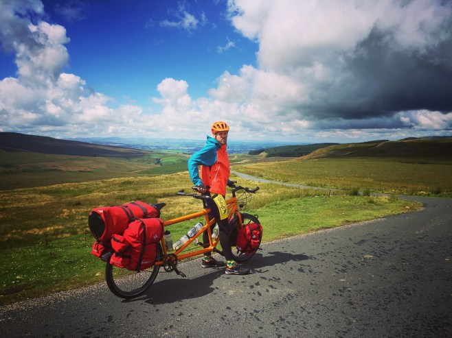 A man on a tandem bicycle in the Yorkshire Dales National Park, in the United Kingdom