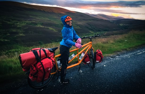A female bicycle rider on a tandem cycling the Scottish Highlands