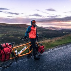 Man with tandem bicycle in Ireland during sunset