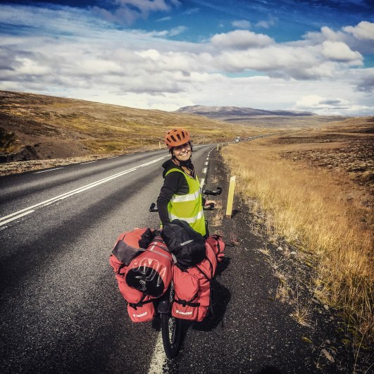 A woman on a tandem bicycle on the way to Akureyri, Iceland