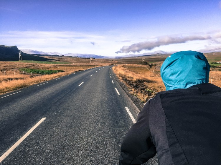 A man from the back riding a bicycle in Iceland