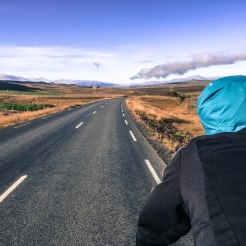 a man on a bicycle on the national road in Iceland