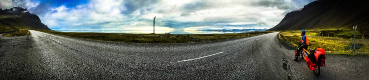A man and a tandem bicycle on the road in Hofn, Iceland